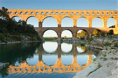 france - Pont du Gard, Roman aqueduct, UNESCO World Heritage Site, River Gard, Languedoc-Roussillon, France, Europe Stock Photo - Premium Royalty-Free, Code: 6119-08517994