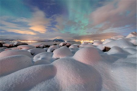 The pink light and the aurora borealis (Northern Lights) illuminate the snowy landscape on a starry night Stronstad, Lofoten Islands, Arctic, Norway Scandinavia, Europe Stock Photo - Premium Royalty-Free, Code: 6119-08641099