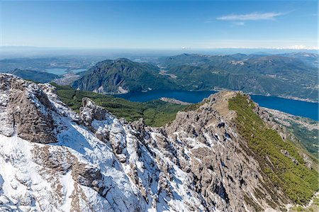Aerial view of the snowy ridges of the Grignetta mountain with Lake Como in the background, Lecco Province, Lombardy, Italy, Europe Stock Photo - Premium Royalty-Free, Code: 6119-08658032