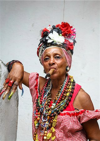 Woman smoking cigar, old Havana, Cuba, West Indies, Caribbean, Central America Stock Photo - Premium Royalty-Free, Code: 6119-08703735