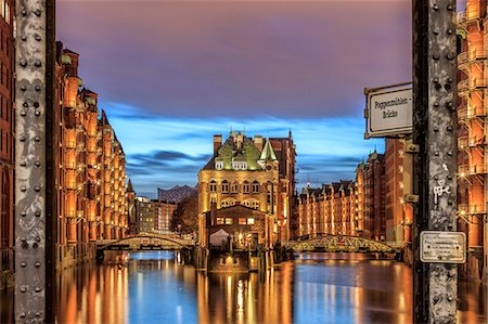 Blue dusk and lights are reflected in Poggenmohlenbrucke with water castle between bridges, Altstadt, Hamburg, Germany, Europe Stock Photo - Premium Royalty-Free, Code: 6119-08724965