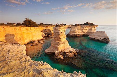 Rocky columns, natural monument, rocky coast at sunrise, Sant'Andrea, Adriatic Sea, Lecce province, Salentine Peninsula, Puglia, Italy, Europe Stock Photo - Premium Royalty-Free, Code: 6119-08724912