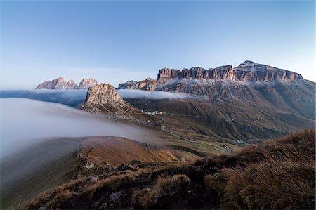 Piz Boa Sassolungo and Sass Beca shrouded in morning fog Cima Belvedere, Canazei, Val di Fassa, Trentino-Alto Adige, Italy, Europe Stock Photo - Premium Royalty-Free, Code: 6119-08841069