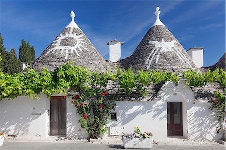 Trulli, traditional houses, Rione Monti area, Alberobello, UNESCO World Heritage Site, Valle d'Itria, Bari district, Puglia, Italy, Europe Stock Photo - Premium Royalty-Free, Code: 6119-08803282