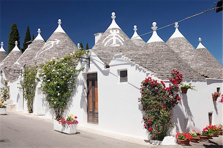 quaint - Trulli, traditional houses, Rione Monti area, Alberobello, UNESCO World Heritage Site, Valle d'Itria, Bari district, Puglia, Italy, Europe Stock Photo - Premium Royalty-Free, Code: 6119-08803285