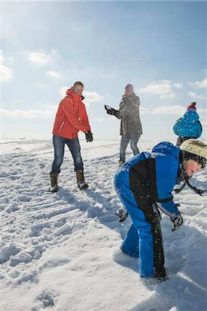 Family having snowball fight, smiling, Bavaria, Germany Stock Photo - Premium Royalty-Free, Code: 6121-07740069