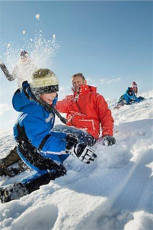 Family having snowball fight, Bavaria, Germany Stock Photo - Premium Royalty-Free, Code: 6121-07740072