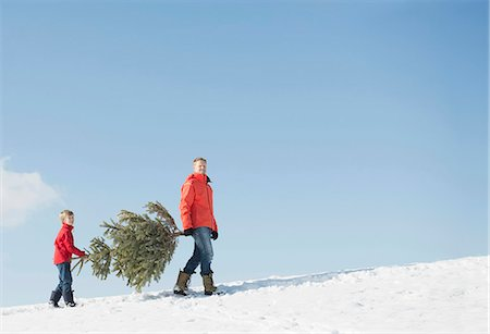 snow christmas tree white - Father and son carrying spruce, Bavaria, Germany Stock Photo - Premium Royalty-Free, Code: 6121-07740026