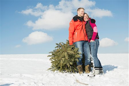 snow christmas tree white - Couple standing with spruce, smiling, Bavaria, Germany Stock Photo - Premium Royalty-Free, Code: 6121-07740034