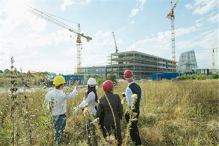 picture - Architect and building owners on site inspection Stock Photo - Premium Royalty-Free, Code: 6121-07740361