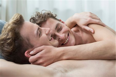 Homosexual couple hugging each other, smiling Stock Photo - Premium Royalty-Free, Code: 6121-07740364