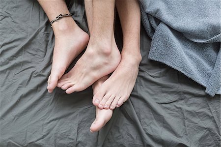 Homosexual couple in bed, close up Stock Photo - Premium Royalty-Free, Code: 6121-07740372