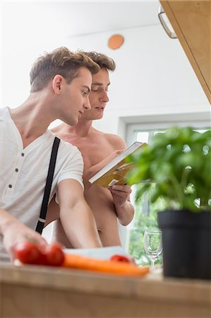 displaying - Homosexual couple cooking food in kitchen Stock Photo - Premium Royalty-Free, Code: 6121-07740384