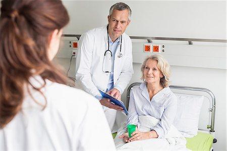 Doctors' visit in hospital Stock Photo - Premium Royalty-Free, Code: 6121-07740448