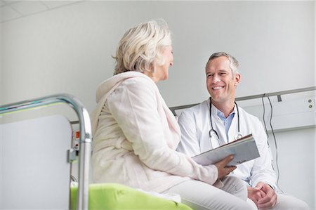 senior speaking to doctor - Doctor listening to patient Stock Photo - Premium Royalty-Free, Code: 6121-07740459