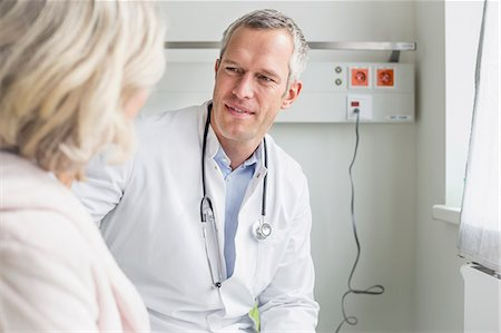 Doctor listening to patient Stock Photo - Premium Royalty-Free, Code: 6121-07740460
