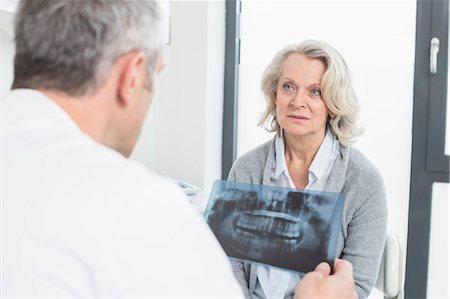 results - Doctor discussing treatment with patient Stock Photo - Premium Royalty-Free, Code: 6121-07740473