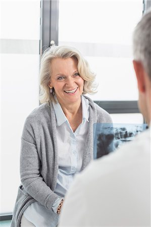 Doctor discussing treatment with patient Stock Photo - Premium Royalty-Free, Code: 6121-07740474