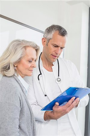 results - Doctor discussing treatment with patient Stock Photo - Premium Royalty-Free, Code: 6121-07740476