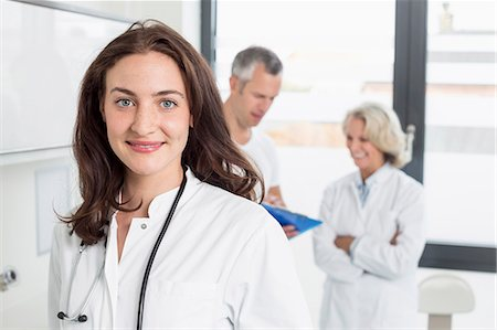 dark hair - Doctors discussing patient's record Stock Photo - Premium Royalty-Free, Code: 6121-07740482