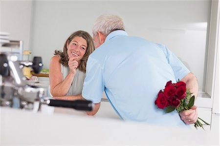 rose - Senior man giving red roses to woman Stock Photo - Premium Royalty-Free, Code: 6121-07740619