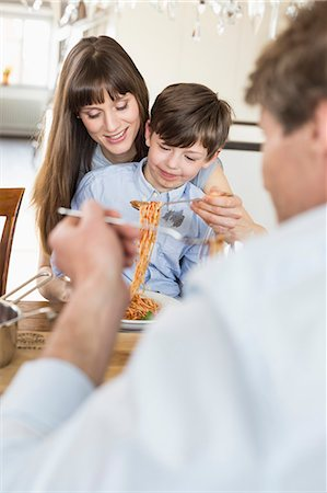stain (dirty) - Family having meal Stock Photo - Premium Royalty-Free, Code: 6121-07740759