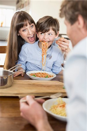 family table eating together - Family having meal Stock Photo - Premium Royalty-Free, Code: 6121-07740760