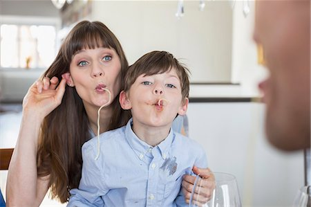 stain (dirty) - Mother and son having fun with spaghetty Stock Photo - Premium Royalty-Free, Code: 6121-07740762