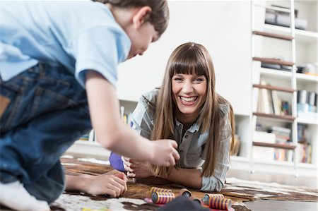 Mother and son playing board game, smiling Stock Photo - Premium Royalty-Free, Code: 6121-07740939