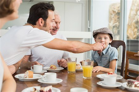 family table eating together - Extended family at table eating cake Stock Photo - Premium Royalty-Free, Code: 6121-07741071