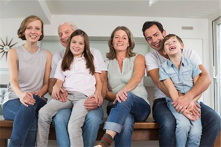 Smiling extended family side by side, portrait Stock Photo - Premium Royalty-Free, Code: 6121-07741084