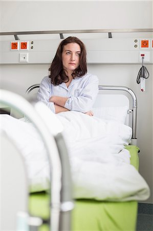 Patient in hospital lying in bed Stock Photo - Premium Royalty-Free, Code: 6121-07741157