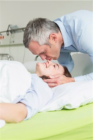husband calling on sick wife in hosptal Stock Photo - Premium Royalty-Free, Code: 6121-07741158