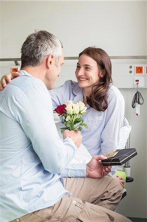 husband calling on sick wife in hosptal Stock Photo - Premium Royalty-Free, Code: 6121-07741161