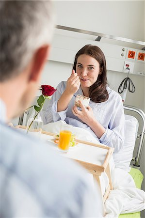 husband calling on sick wife in hosptal Stock Photo - Premium Royalty-Free, Code: 6121-07741162