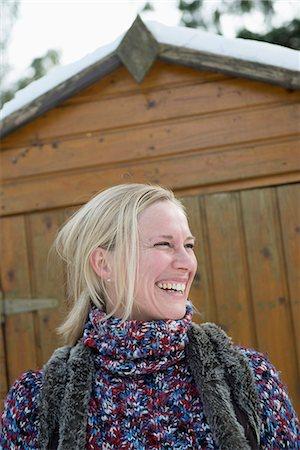 Woman looking away, smiling, Bavaria, Germany Stock Photo - Premium Royalty-Free, Code: 6121-07741284