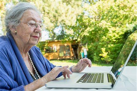 Female senior using laptop Stock Photo - Premium Royalty-Free, Code: 6121-07741212