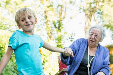 Grandmother and her grandson in the garden Stock Photo - Premium Royalty-Free, Code: 6121-07741217
