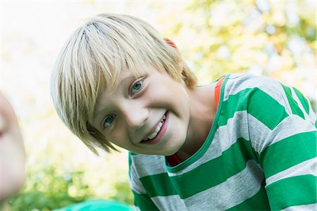 preteen  smile  one  alone - Portrait of smiling young boy, close-up Stock Photo - Premium Royalty-Free, Code: 6121-07741229