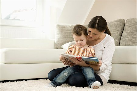 Mother and son are watching storybook Stock Photo - Premium Royalty-Free, Code: 6121-07741449