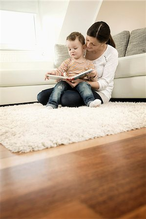 story - Mother and son are watching storybook, smiling Stock Photo - Premium Royalty-Free, Code: 6121-07741452