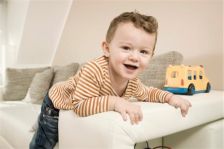 Portrait of boy playing with toys, smiling Stock Photo - Premium Royalty-Free, Code: 6121-07741457