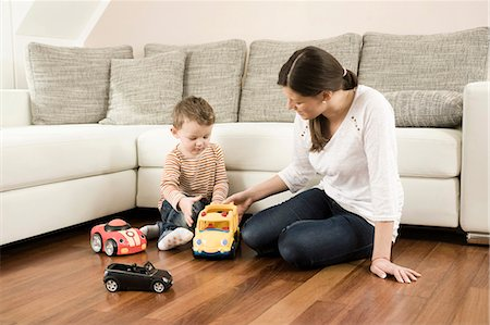 Mother and son playing with toys Stock Photo - Premium Royalty-Free, Code: 6121-07741455