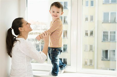 standing - Mother and son smiling Stock Photo - Premium Royalty-Free, Code: 6121-07741459