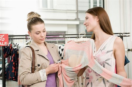 selecting - Sales girl with customer in fashion store Stock Photo - Premium Royalty-Free, Code: 6121-07741492