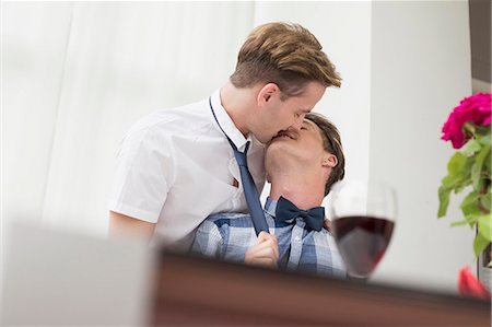 Homosexual couple kissing each other Stock Photo - Premium Royalty-Free, Code: 6121-07741407