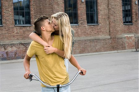 Teenage couple kissing each other Stock Photo - Premium Royalty-Free, Code: 6121-07741549