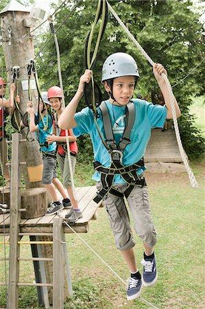 Boys and girls climbing crag Stock Photo - Premium Royalty-Free, Code: 6121-07741644