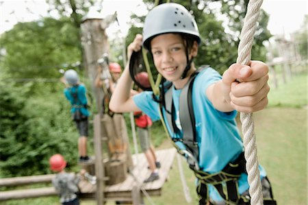 Boys and girls climbing crag Stock Photo - Premium Royalty-Free, Code: 6121-07741645