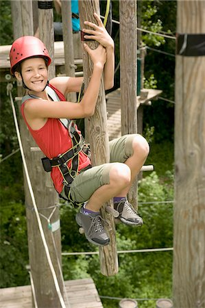 Girl and boy climbing crag, smiling Stock Photo - Premium Royalty-Free, Code: 6121-07741665